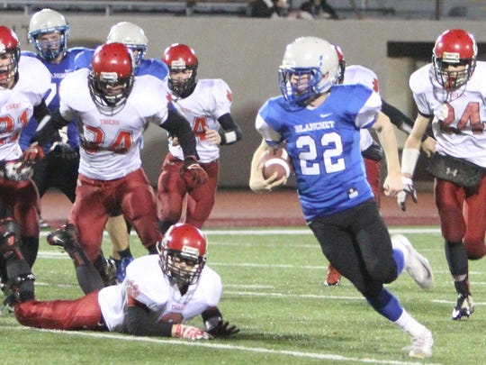 Blanchet running back Kevin McCarthy (22) runs past a bunch of Clatskanie defenders in a 24-12 win in the first round of the OSAA Class 3A state playoffs on Saturday, Nov. 7, 2015.