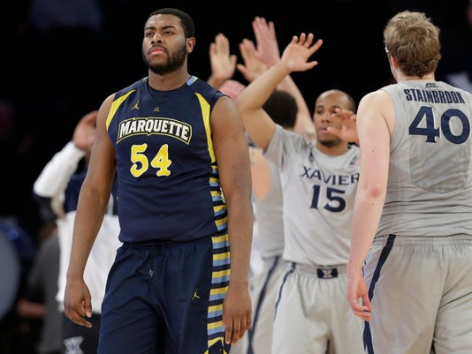Marquette's Davante Gardner (54) reacts as he leaves the floor during the after an NCAA college basketball game against Xavier in the quarterfinals of the Big East men's tournament Thursday, March 13, 2014, at Madison Square Garden in New York. Xavier won 68-65. (AP Photo/Frank Franklin II)