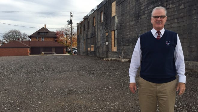 Bucyrus Mayor Jeff Reser stands in front of the future site of the Schine's Arts Park at South Sandusky Avenue and East Warren Street. The park is a short-term priority for the mayor. It will take the place of the old Schine's Theater, which was demolished last summer.