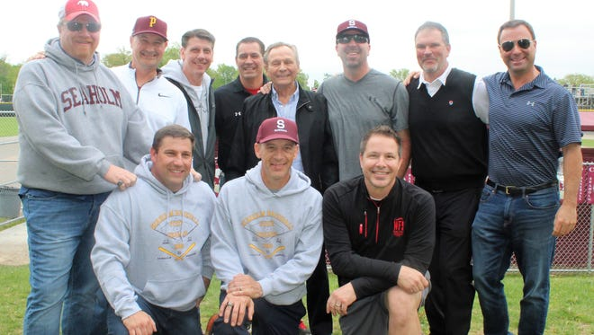 Members of the 1988 Birmingham Seaholm baseball team, dubbed the 'Miracle Maples,' pose for a photo at Saturday's 30-year reunion. Those members in attendance included (kneeling left to right) Chris Kauth, Mike Carroll, Matt Newton; (standing left to right) Crede Colgan, Jason Smith (bullpen pitcher and '85 Seaholm grad), Todd Glandt, Mark Sackett (assistant coach), Don Sackett (head coach), Rob Kaye, Jon Lanesky and Brett Russell.
