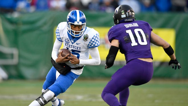 Kentucky quarterback Stephen Johnson (15) scrambles during the first half of the Music City Bowl at Nissan Stadium in Nashville, Tenn., Friday, Dec. 29, 2017.