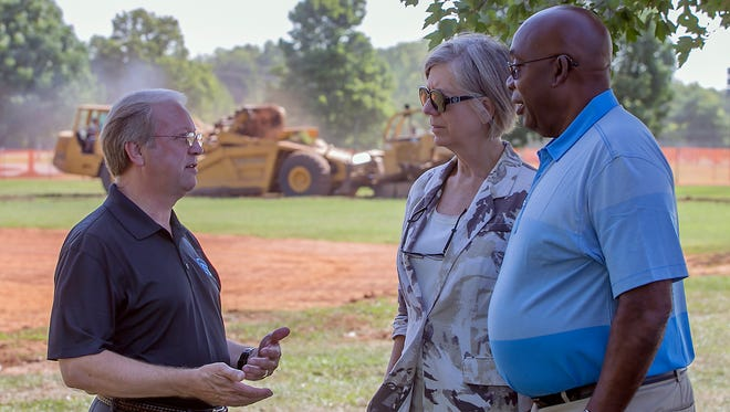 Murfreesboro Parks & Rec. Director Lanny Goodwin, left, talks with Debbie and Bonnie Price, parents of Boston Red Sox pitcher David Price, as the work has begun on the Miracle Field with earth moving equipment removing top soil in the background.
