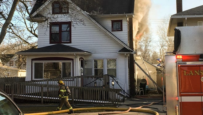 Lansing firefighters battle a house fire Saturday, March 4, 2017, in the 1300 block of West Shiawassee Street.