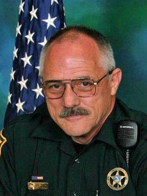 In this undated photo provided by the Okaloosa Sheriff's Office, shows Deputy Bill Myers. Authorities say Myers was killed by Joel Dixon Smith as Myers was serving a domestic violence injunction at a law office in Shalimar, Fla., Tuesday, Sept. 22, 2015. (Okaloosa Sheriff's Office via AP)