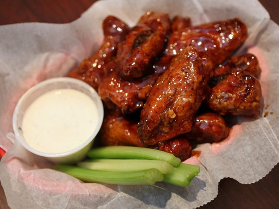 Smokey D's BBQ is located just north of I-80 on 2nd Ave. Shown here is the smoked wings appetizer. Mary Chind/The Des Moines Register
