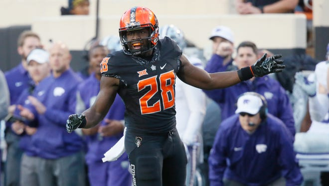 Oklahoma State wide receiver James Washington (28) reacts after missing a pass in the first half of an NCAA college football game against Kansas State in Stillwater, Okla., Saturday, Nov. 18, 2017. Kansas State won 45-40.