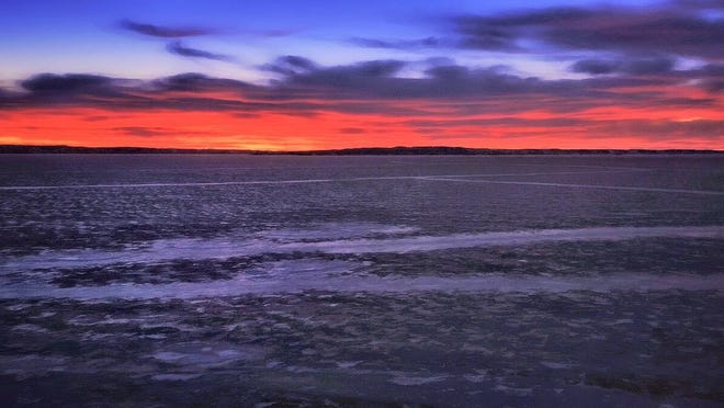 Sean Heavey piloted a drone to capture this image of sunrise over a frozen Fort Peck reservoir.