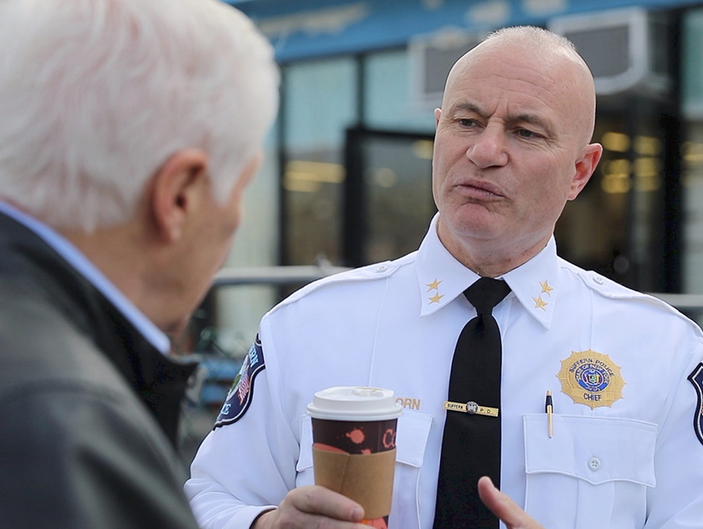 Suffern Police Chief Clarke Osborn, right, talks with