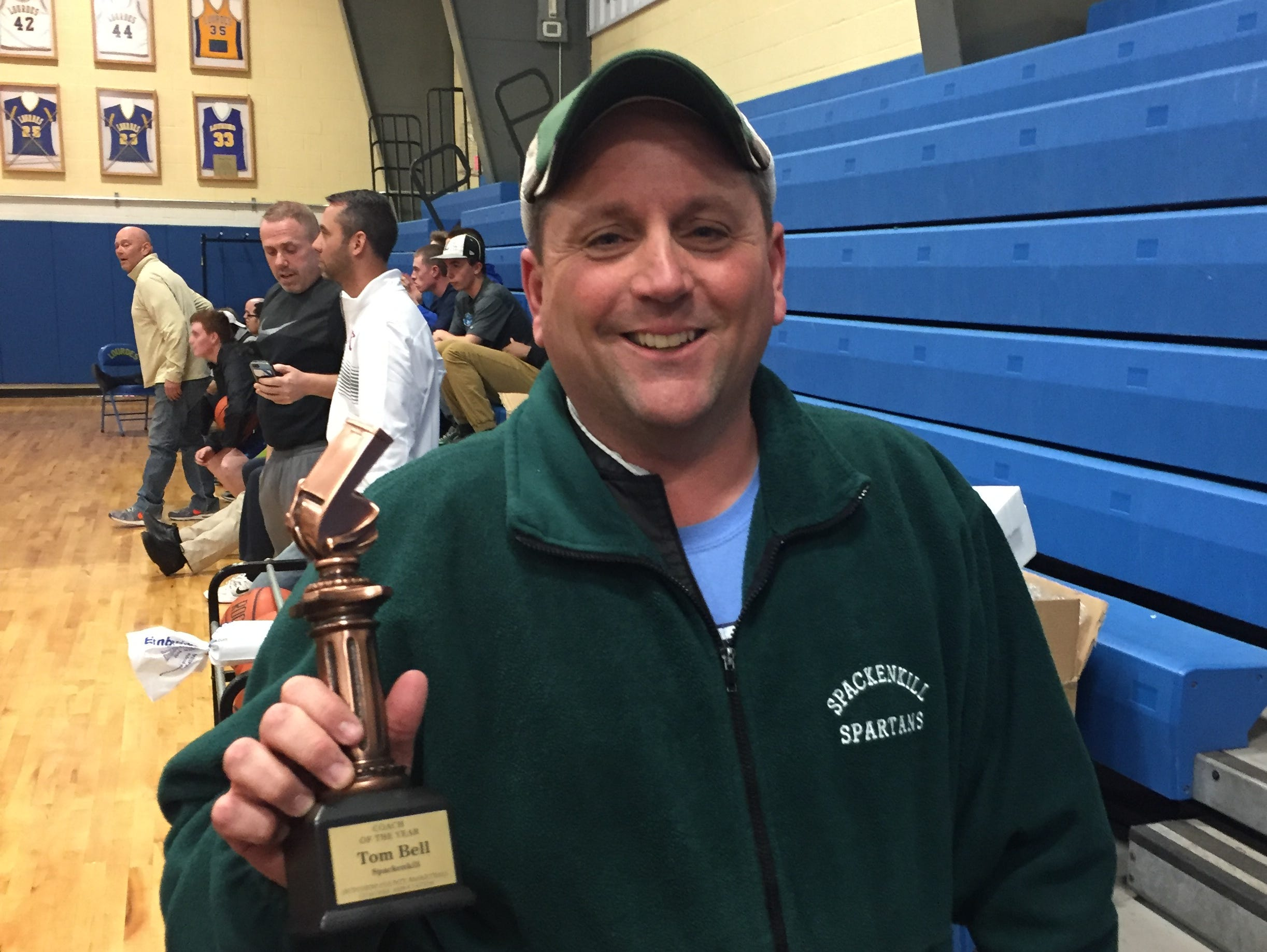 Spackenkill's Tom Bell was named Coach of the Year by the Dutchess County Basketball Coaches Association on Monday at the Exceptional Senior game at Our Lady of Lourdes High School.