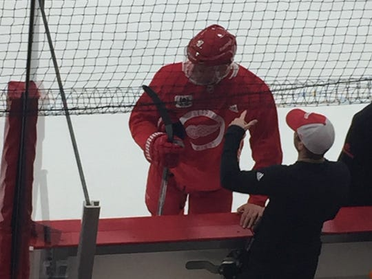 Justin Abdelkader with a protective shield across his