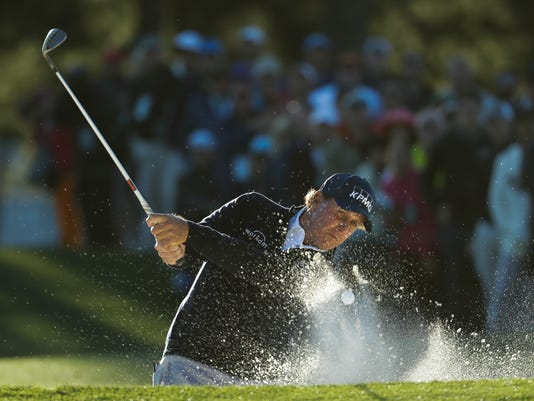 Phil Mickelson hits from a bunker on the 17th hole during the second round of the Masters golf tournament Friday, April 7, 2017, in Augusta, Ga. (AP Photo/Chris Carlson)