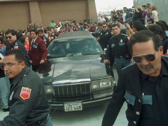 El Paso Police try to part the crowd as Oscar de la Hoya's limo leaves the rear of Speaking Rock Casino. Approximately 2000 people waited out front for de la Hoya. When he arrived by a rear entrance many moved to the back to watch him leave.