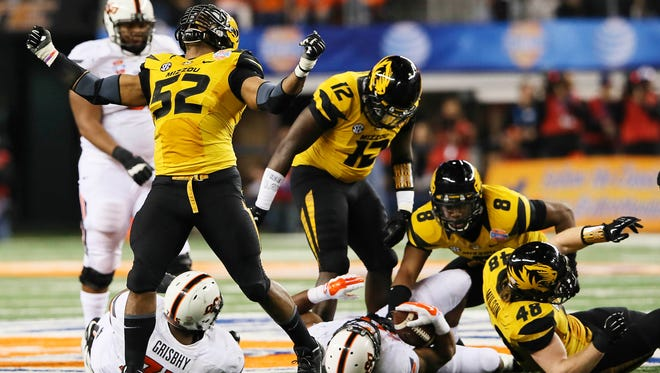 Missouri Tigers defensive lineman Michael Sam (52) reacts after a play during the second half against the Oklahoma State Cowboys in the 2014 Cotton Bowl at AT&T Stadium. Mandatory Credit: Kevin Jairaj-USA TODAY Sports ORG XMIT: USATSI-164864 ORIG FILE ID:  20140103_krj_aj6_455.jpg