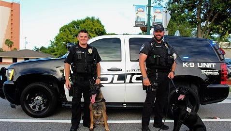Titusville Police Department K9 Officer Brendan Distler and  Scooby (left) with  K9 Officer Mark Jennings and Chase. Scooby and Chase, litter mates, are Belgian Malinois. They came to Titusville from a breeder in Belgium.