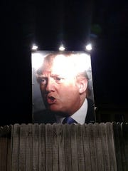 Giant sign of Donald Trump at West Des Moines home.