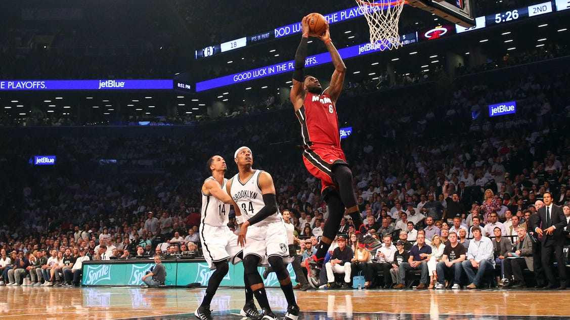 LeBron James ties playoff career high as Heat beat Nets in Game 4