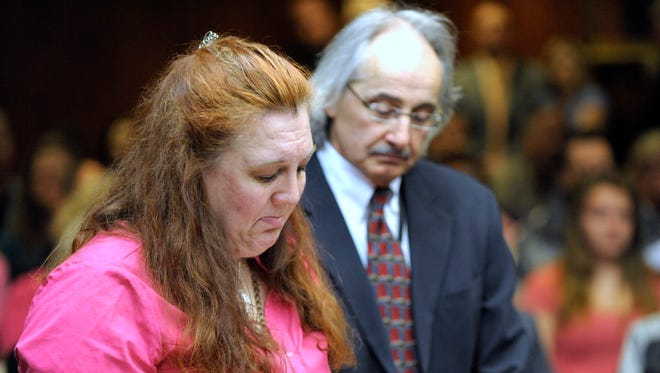 Jennifer Millsap, mother of murder victim April Millsap, keeps her emotions in check as she reads her victim's impact statement as Macomb County's Chief of Homicide Bill Cataldo, right, stands with her..