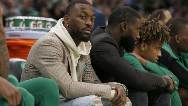 The Celtics' Kemba Walker sits on the bench to rest his ailing knee for a game in January. Walker did the same on Monday when the Celtics practiced at Disney World.