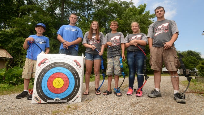 Maysville's Mathew Harper, left, and Dalton Talbert and Crooksville's Ashley Compston, Gavin Keirns, Hope Stickdorn and Larry Eyman competed in the NASP World Tournament and World IBO 3D Challenge in Myrtle Beach. Harper, Talbert and Keirns also won national championships.