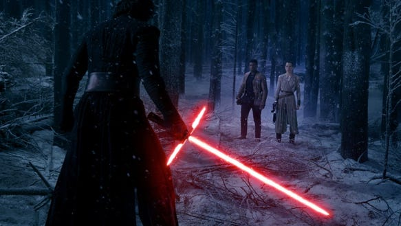 Kylo Ren has his lightsaber ready against Finn and