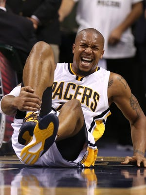 Pacers' David West reacts in pain after a hard play against the Dallas Mavericks at Bankers Life Fieldhouse Oct. 18, 2014.