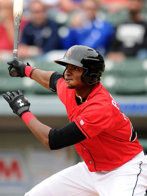 Indianapolis Indians batter Gregory Polanco watches the ball off his bat against the Columbus Clippers at Victory Field, Sunday, April 13, 2014, in Indianapolis.