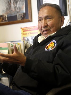 George Werito, station manager for KNDN AM radio station based in Farmington, talks in his office during an interview on Jan. 24, 2013.