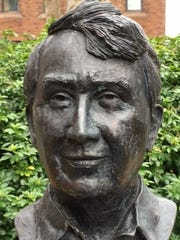 A bust of Frank McCourt outside the Frank McCourt Museum