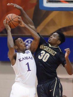 Vanderbilt center Damian Jones (30) defends Kansas guard Wayne Selden Jr. (1) in the Jayhawks' win on Nov. 25, 2015.