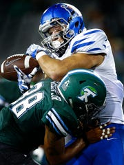 University of Memphis tight end Daniel Montiel (right) can not hang onto a pass after being hit by Tulane University safety Roderic Teamer (left) during third quarter action at Yulman Stadium in New Orleans.
