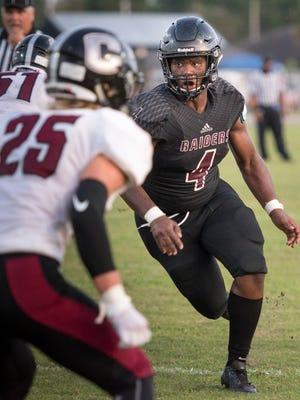 Navarre's Josh Carter (4) tries to get to the ball carrier during the Chiles vs Navarre preseason football jamboree game at Navarre High School on Thursday, August 17, 2017.