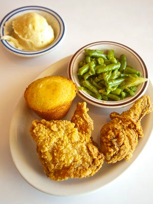 Franco's fried chicken is a specialty of the house, here served with corn bread, green beens with smoked turkey and mashed potatoes.