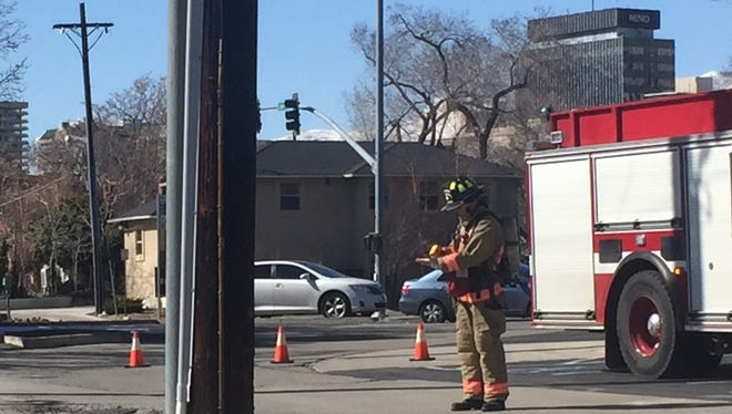A Reno Fire Department crew member works the scene of an electrical vault issue Tuesday, Feb. 27, 2018 at 500 Ryland Street.