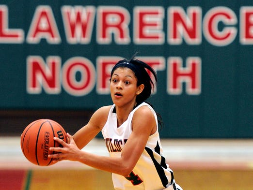 Lawrence North's Ana Owens controls the ball against Columbus North, Nov, 30, 2013, at Lawrence North.