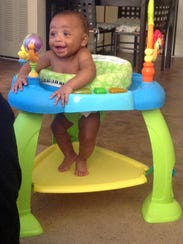Seven month-old Martin DeShawn McCullough smiles in