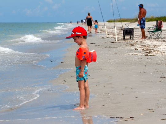 Dennis Hauser, 4, looks for shells on Bowman's Beach on July 10.