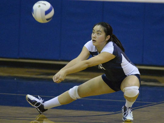 Setter Kelly Chen and the NV/Old Tappan girls volleyball