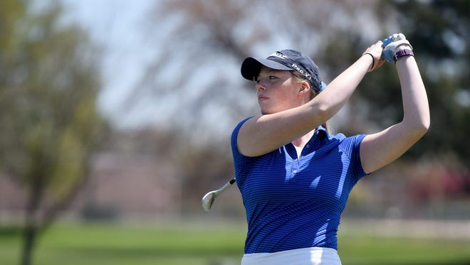 O'Gorman's Emily Olson tees off during the city meet at Elmwood Golf Course on Tuesday.