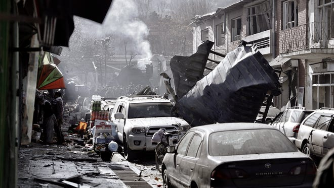 Smoke billows from the scene of an apparent suicide bomb attack in Kabul, Afghanistan.