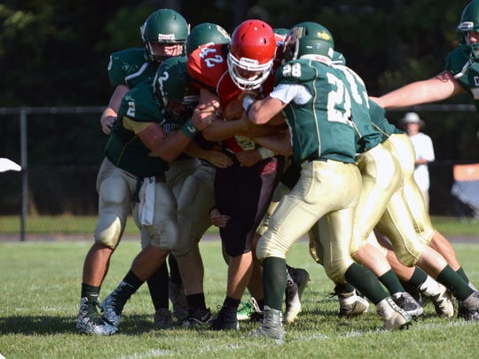 Riverheads fullback Moose Lee keeps his feet despite the efforts of six East Hardy, W.Va., defenders during their scrimmage at the Riverheads Jamboree on Saturday, Aug. 19, 2017, at Riverheads High School in Greenville, Va.