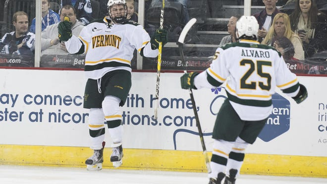 Vermont celebrates a goal during the men's hockey game between the Vermont Catamounts and the Quinnipiac Bobcats in the championship game of the Friendship Four hockey tournament at the SSE Arena on Saturday evening November 26, 2016 in Belfast, Ireland.