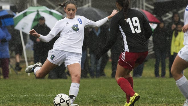 Colchester's Brenna McMannon (9) kicks the ball during the girls soccer game between the Champlain Valley Union Redhawks and the Colchester Lakers at Colchester High School on Saturday morning October 22, 2016 in Colchester. (BRIAN JENKINS/for the FREE PRESS)