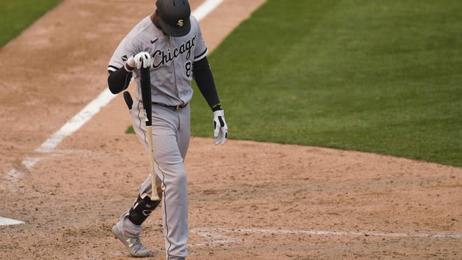 Chicago White Sox's Luis Robert walks toward the dugout after striking out against the Oakland Athletics during the ninth inning Thursday in Oakland, Calif.