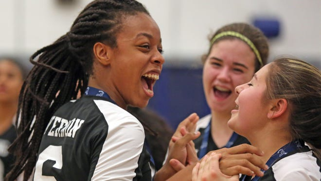 Ossining's Mychael Vernon (6) celebrates with her team their win over Ursuline School during Section 1 Class AA girls volleyball finals at Hendrick Hudson High School in Montrose on Nov. 4, 2016.