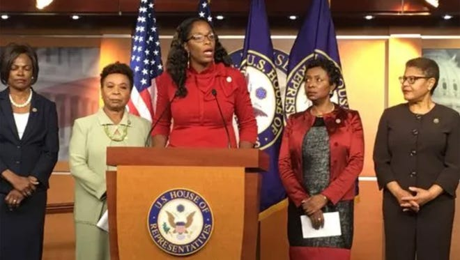 Rep. Stacey Plaskett, a Democrat from the Virgin Islands, discusses the need for disaster aid during a news conference of the Congressional Black Caucus in the Capitol on Oct. 12, 2017