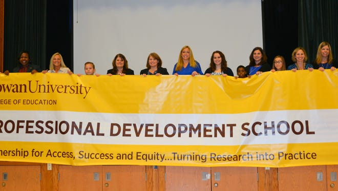 Johnstone Elementary School and Rowan University renewed their partnership last week during the unveiling of a new banner promoting Johnstone's status as a Professional Development School.