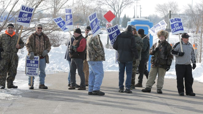 """Workers at AxleTech International went on strike Monday, Feb. 6, 2017, after recent contract negotiations stalled. The United Automobile Workers Local 291 called the strike at 6 a.m. after the union and the company """"failed to reach an agreement by the Jan. 29 contract expiration deadline,"""" according to a union news release. About 60 employees carried signs and marched along sidewalks in front of the company's facility, 1005 High Ave., near the University of Wisconsin-Oshkosh campus."""