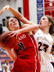 Oakland's Claira McGowen (11) goes up for a shot as