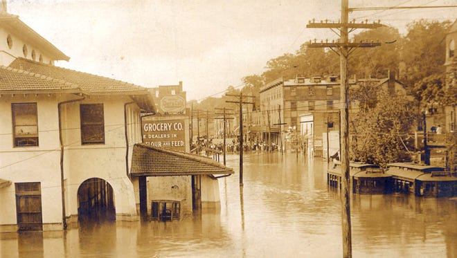 "A still from ""Come Hell or High Water"" shows the damage from 1916's flood in Asheville."