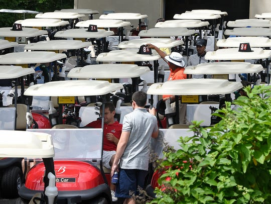 Golf carts are prepared for an event Wednesday, July